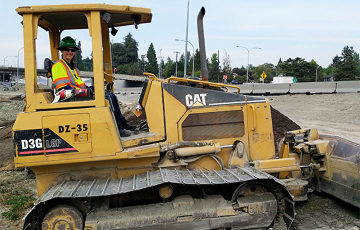 student operating a bulldozer