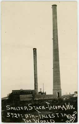 a historical photo showing 2 smokestacks