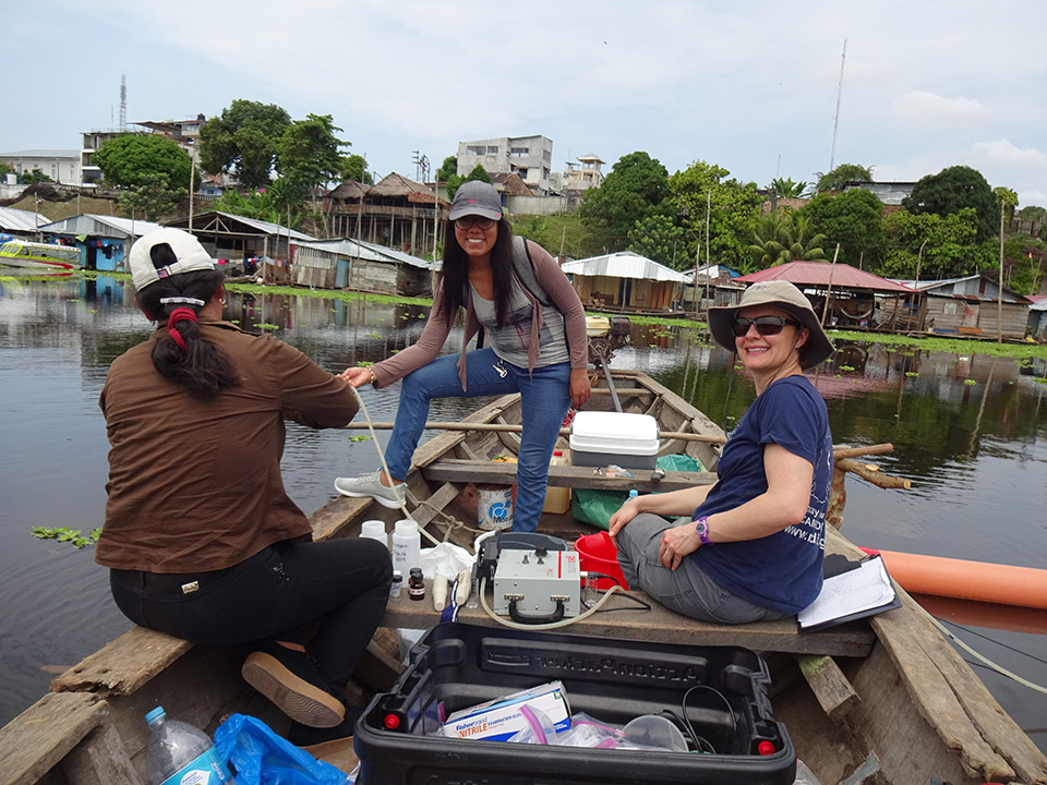 photo of Becca Neuman and two researchers on a boat
