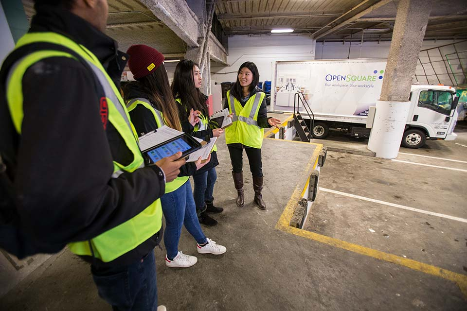 photo of team waiting for deliveries at the loading bay