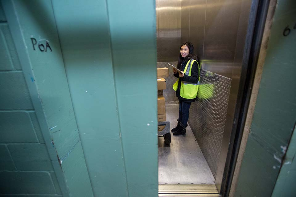 photo of a data collector in elevator