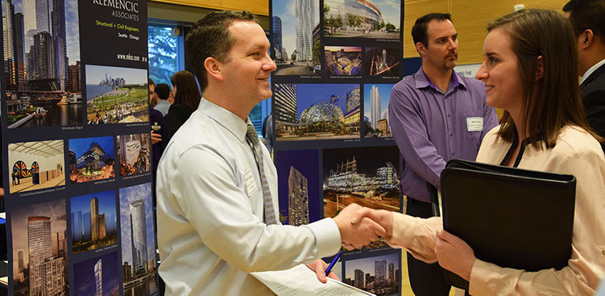 career fair participants shaking hands