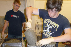 students making concrete cylinders