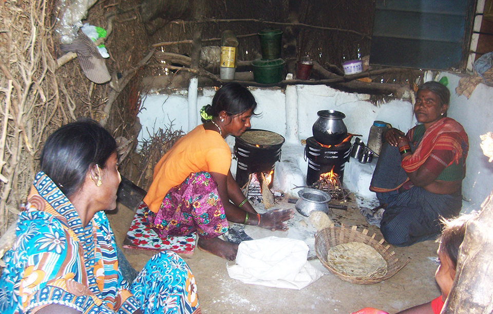 villagers around cook stove