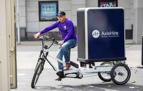 Demoing a three-wheeled electric bike