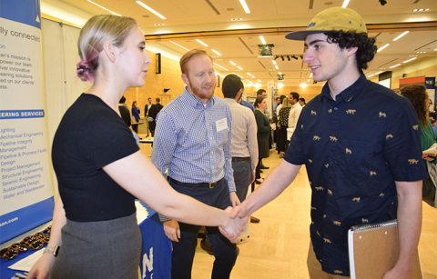 Two people shaking hands at CEE Career Fair